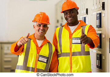 power company technical co-workers with thumbs up - handsome...