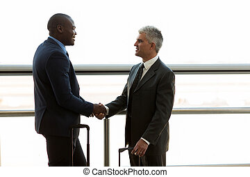 businessmen hand shaking - two professional businessmen hand...
