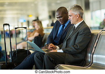 business travelers using laptop - successful business...