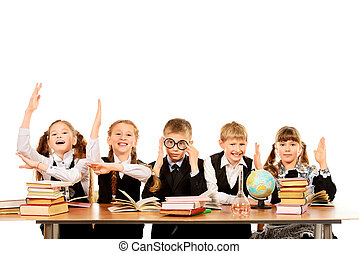 good students - Schoolchildren sit together at the table and...