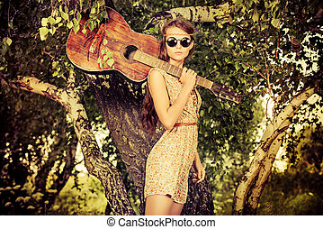 girl guitarist - Romantic girl travelling with her guitar...