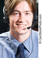 telesales marketer - a smiling handsome telesales marketer