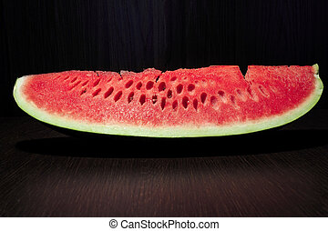 Fresh slice of red watermelon no dark brown table