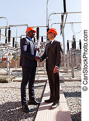 power company managers handshaking
