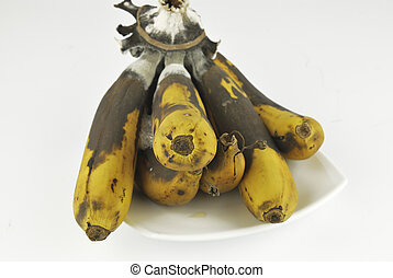 Rotten banana with fungus on white background