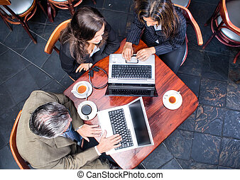 business meeting - aerial view of three people in business...
