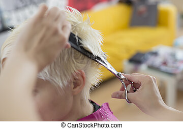 Young woman at hairdresser