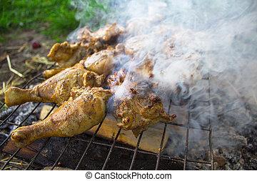 Chicken legs in smoke