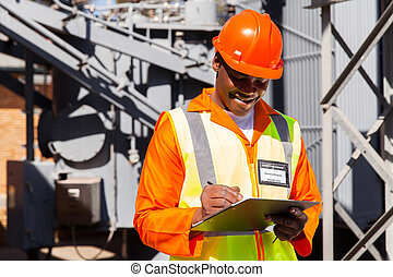 african electrician writing on clipboard - happy african...