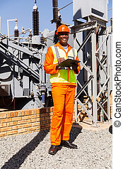 afro american electrical engineer in power plant - happy...