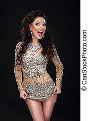 Cheerful Woman in Shiny Silver Stagy Dress Having Fun