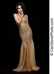 Elegance. Aristocratic Lady in Golden Long Dress over Black...