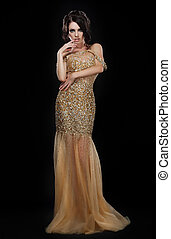 Formal Party Glamorous Fashion Model in Elegant Golden Dress...