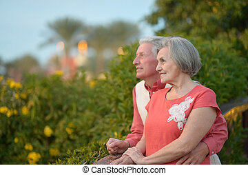 Mature couple on the walk - Cheerful mature couple on the...