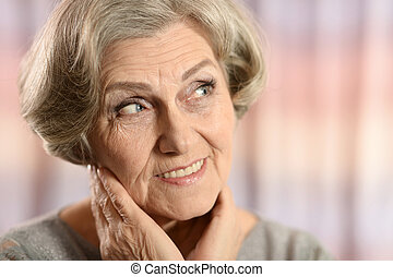 Happy elderly woman isolated on color background