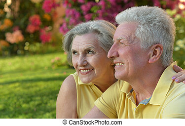 Retired couple outdoor in summer park - Portrait of...