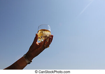 Whiskey - Woman's hand holds a glass of whiskey with ice