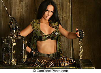 Brunette woman with bullets and knife - Beautiful sexy...