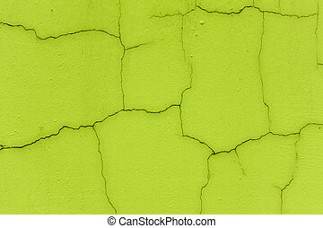 Cracked wall in neon green color