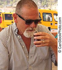 An englishman drinking turkish tea while in turkey