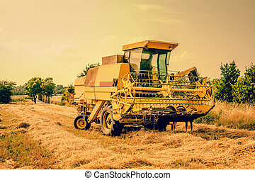Yellow agricultural harvester machine - Agricultural...