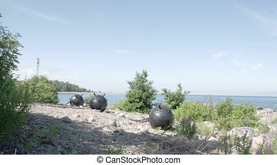 Three big sea mines found on the rocky shore of the sea...