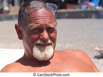 A tanned englishman relaxing on holiday