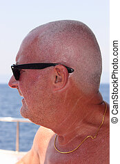 An englishman on vacation wearing sunglasses