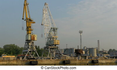 The huge cranes on standby on the harbour port in Estonia It...