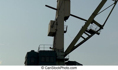 The big part of the crane that operates on the port harbour...
