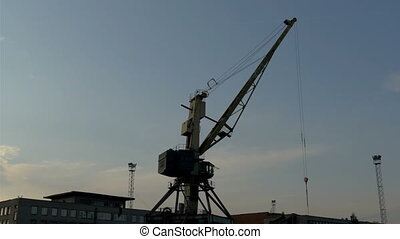 Big crane on standby on a dusky afternoon in the port The...
