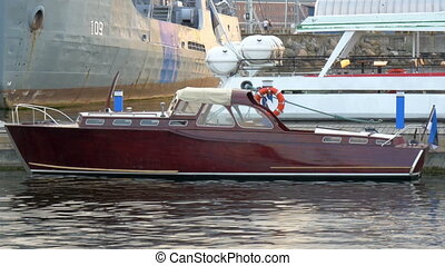 A small vintage like yacht for private use on dock. Looks...