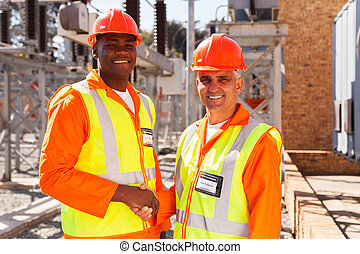 technical co-workers hand shaking - portrait of technical...