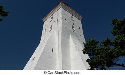 The big body of the white lighthouse in Kopu Estonia - The...