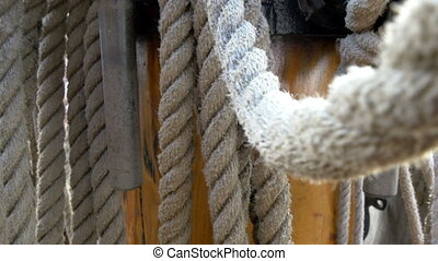 Huge set of ropes used on the big ship on the harbour They...