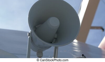 A white small megaphone attached on the yacht on dock on the...