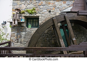 Mill wheel - Mill-wheel. Rotating old wooden water wheel...