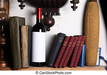 Red wine and books - Bottle of red wine with blank label...