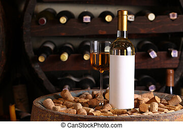 White wine in wine cellar - Bottle of white wine with blank...