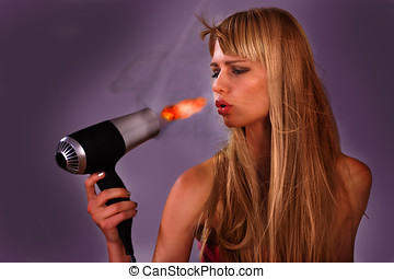 Hairdryer fire woman - Woman surprised with hairdryer fire,...