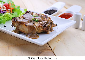 Grilled steaks, pork with pepper gravy and vegetable salad -...