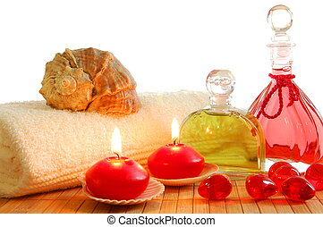 red massage still life with towel candles and copyspace...