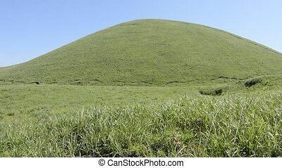 Hemispherical hill - Green hemispherical hill in the grassy...
