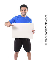 young attractive sport man holding blank billboard as copy...