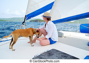 Young woman sailing on a luxury yacht - Young woman and her...