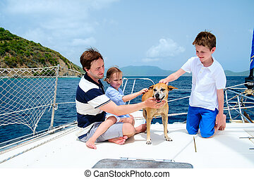 Family sailing on a luxury yacht - Father, kids and their...