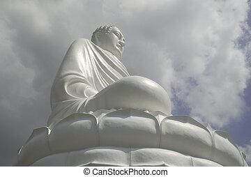 Buddha statue in the clouds