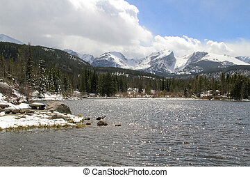 Rocky mountain lake and peaks - snow covered mountain peaks...