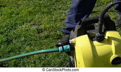 man hose attach - Closeup of man hand detach water hose to...
