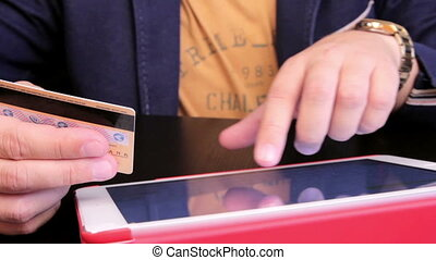 Using a credit card - Businessman using a credit card and a...